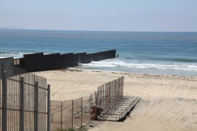 Border fence extends into the water