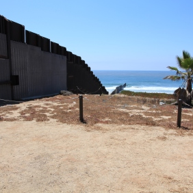 Border fence leading to the Pacific Ocean