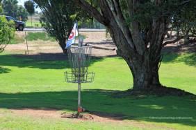 "The ""hole"" on a disc golf course"